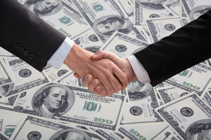 handshake in front of money